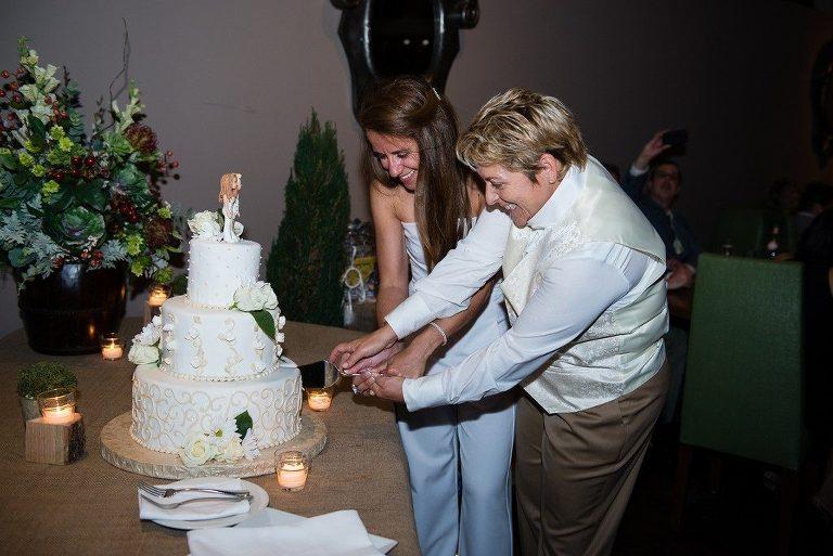 Brides cutting the cake at wedding reception in Burlington ma