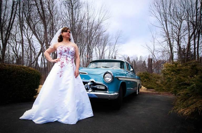 Bride with vintage car