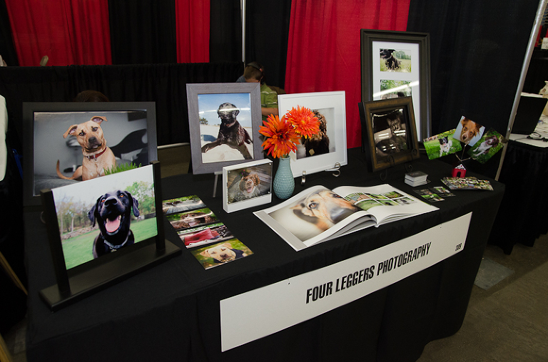 Pet expo table with albums and products