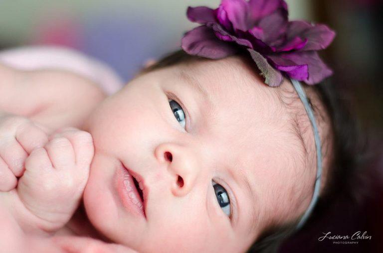 Baby girl with purple headband