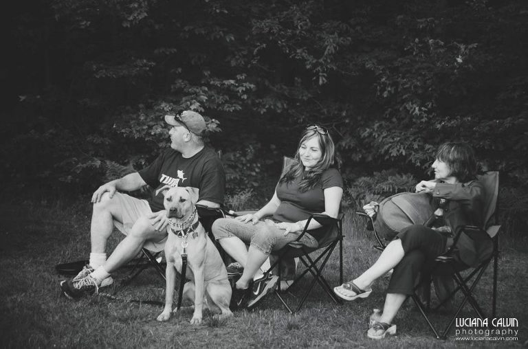 family watches baseball game