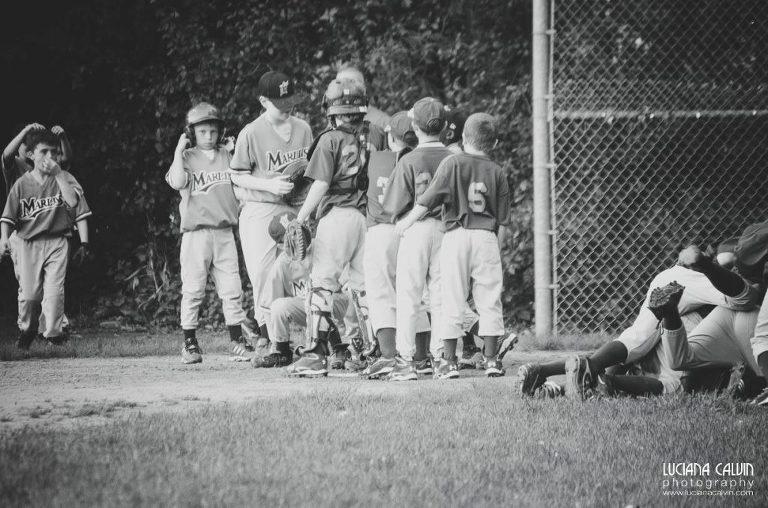 boy on baseball game  with team