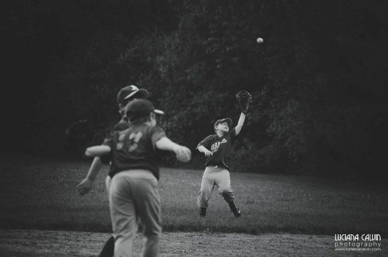 boy on baseball game catching a ball