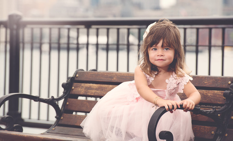 Little girl on a bench in Boston