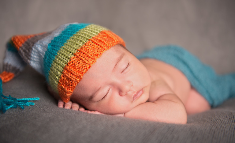 newborn sleeping with a cute hat