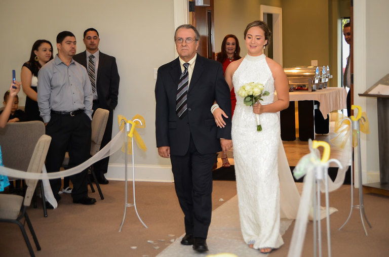 bride walking with father on the idle