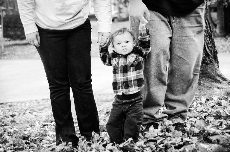 Baby boy being held by parents