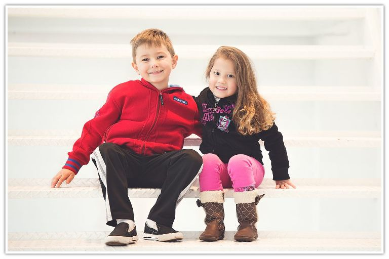 cousins hugging on white stairs
