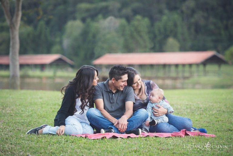 family seating on grass for family portrait