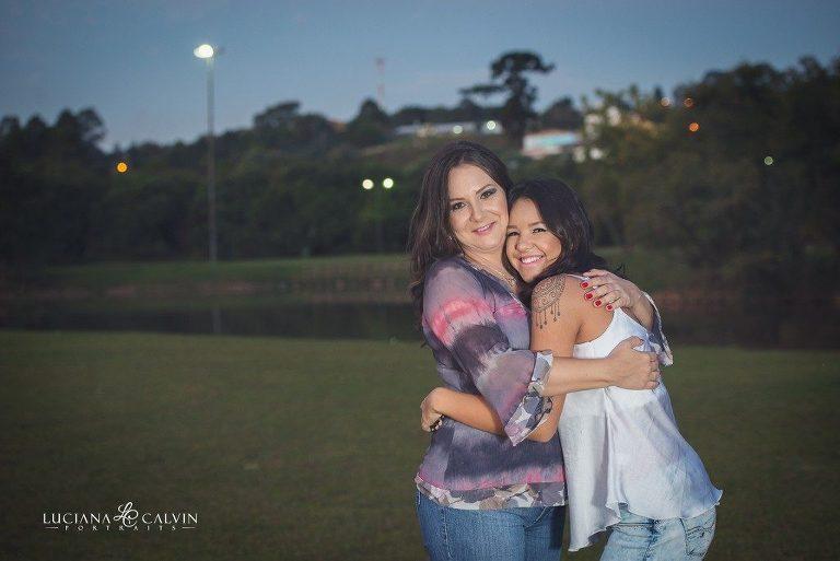 Mother and older daughter hugging