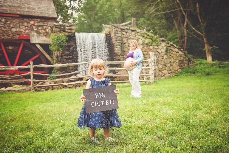 little girl announcing little sisters coming