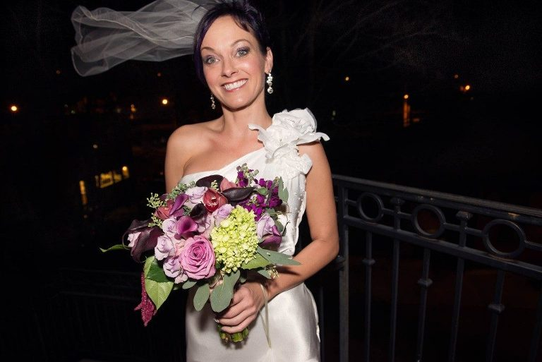 Bride holding a beautiful flower bouquet