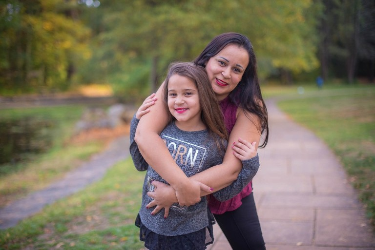 mother and daughter hugging in the park