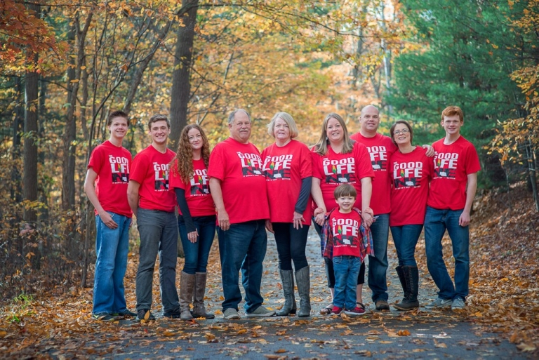 large family posing with red t-shirts