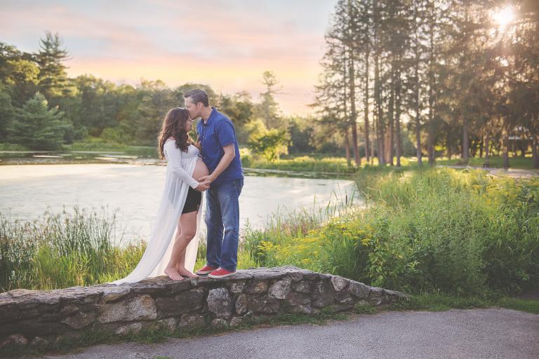 Couple kissing on sunset background in Nashua